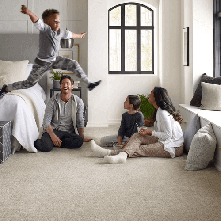 Family enjoying on Carpet | Vic's Carpet & Flooring