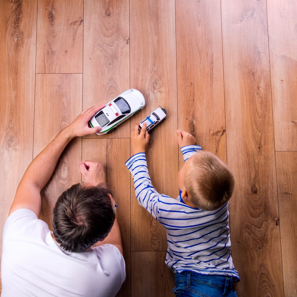Father with kid playing with toycar | Vic's Carpet & Flooring