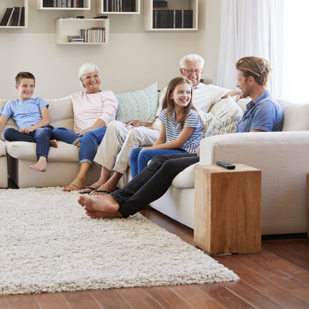 Family gosping in living room | Vic's Carpet & Flooring
